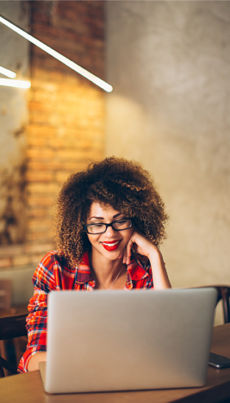 A woman on computer smiling